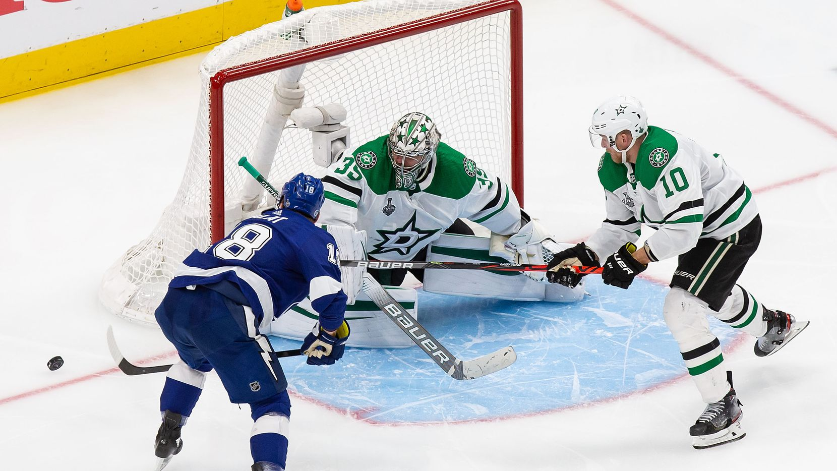Corey Perry (10) and goaltender Anton Khudobin (35) of the Dallas Stars fend off Ondrej Palat (18) of the Tampa Bay Lightning during Game Two of the Stanley Cup Final at Rogers Place in Edmonton, Alberta, Canada on Monday, September 21, 2020.