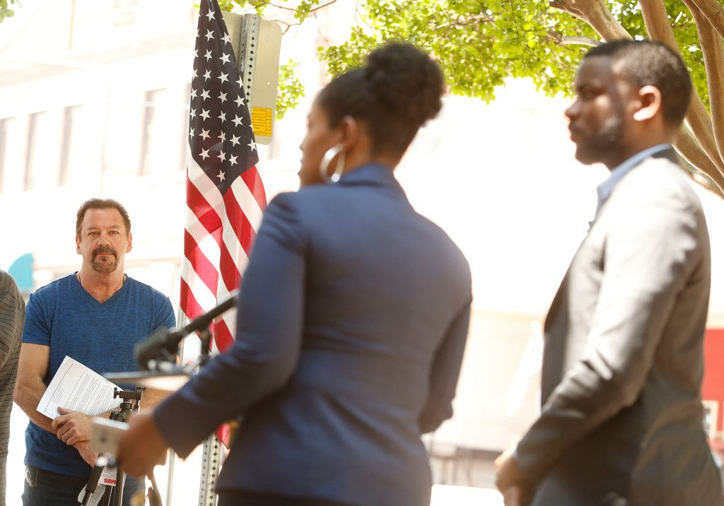 Kim T. Cole (center) and Dominique Alexander (right) hold a press conference about a dispute with McKinney mayor George Fuller (left) dealings with the Craig Ranch community pool incident in front of City Hall in McKinney, Texas on May 29, 2018.