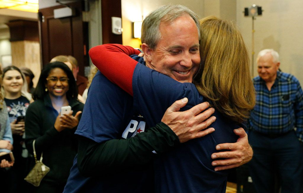 Angela Paxton embraces her husband Ken (left) as they made their appearance at her election return party at the Marriott Courtyard in Allen on March 6, 2018.