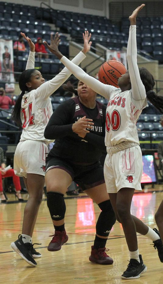 Mansfield Timberview post Trinity King (32), center, is swarmed by the aggressive defense of Mansfield Legacy guards Eryn Scott (24) and Coniah Cooley (00) during first half action. The two teams played their District 8-5A girls basketball game at Mansfield Legacy High school on January 22 , 2021. (Steve Hamm/ Special Contributor)
