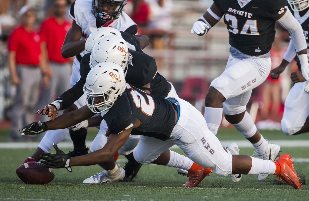 Arlington Bowie defensive back Kameron Sanders (27) recovers a fumble by Flower Mound Marcus running back Ty'son Edwards (22) during the first quarter of a high school football game between Flower Mound Marcus and Arlington Bowie on Thursday, August 29, 2019 at Wilemon Field in Arlington. (Ashley Landis/The Dallas Morning News)