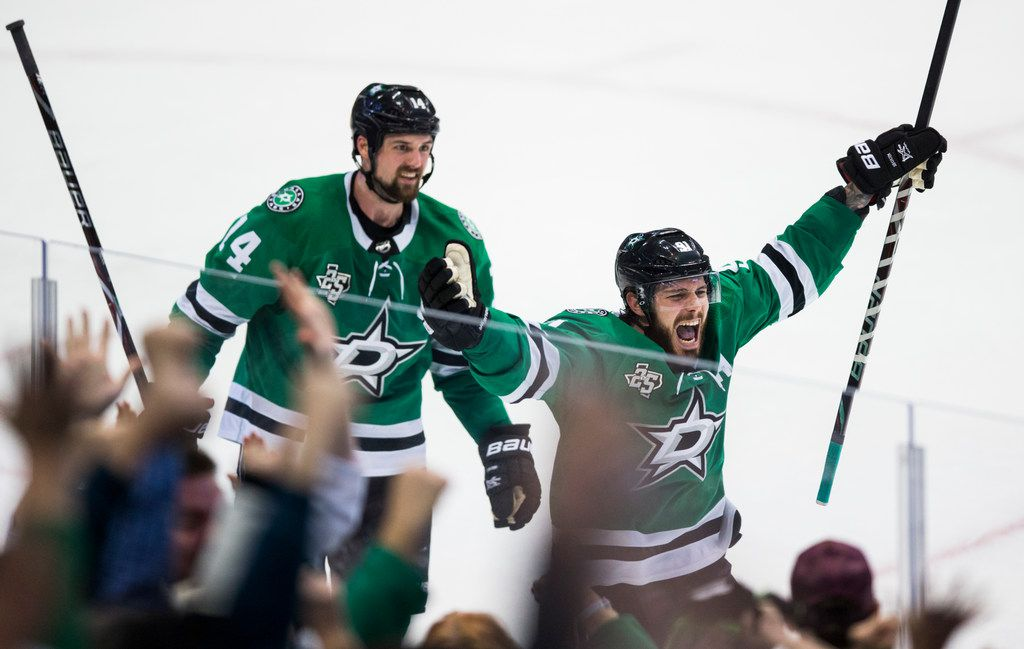 Dallas Stars center Tyler Seguin (91) and left wing Jamie Benn (14) celebrate a goal that tied the game in the last four seconds of regulation play of an NHL hockey game between the Dallas Stars and the Tampa Bay Lightning on Thursday, March 1, 2018 at the American Airlines Center in Dallas.
