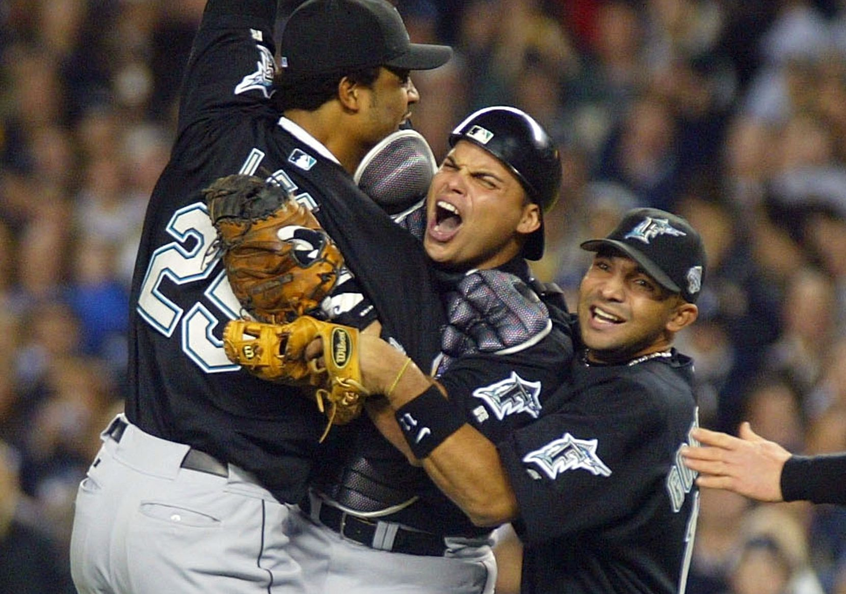 BRONX, NY - OCTOBER 25: Ivan Rodriguez #7 of the Florida Marlins celebrates with teammates Derrek Lee #25 and Alex Gonzalez #11 after defeating the New York Yankees 2-0 in game six of the Major League Baseball World Series on October 25, 2003 at Yankee Stadium in the Bronx, New York. (Photo by Al Bello/Getty Images)
