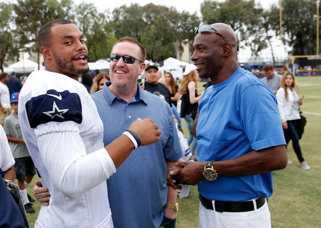 FILE - Cowboys quarterback Dak Prescott (4) and his father, Nathaniel (right), are pictured together after an afternoon practice at training camp in Oxnard, Calif., on Saturday, July 29, 2017. (Vernon Bryant/The Dallas Morning News)