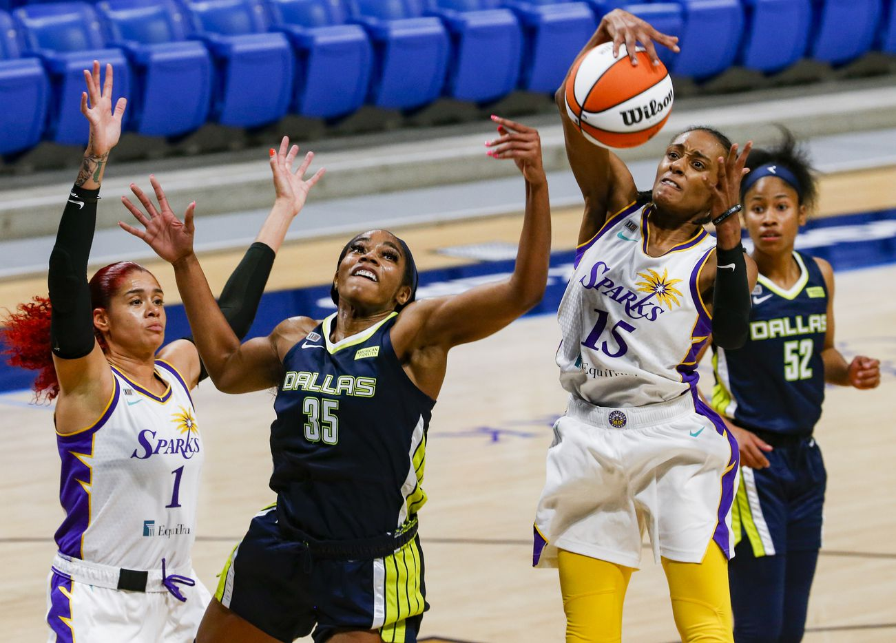 Dallas Wings forward/center Charli Collier (35) tries to get the ball from Los Angeles Sparks guard Brittney Sykes (15) during the first quarter at College Park Center on Tuesday, June 1, 2021, in Arlington. (Juan Figueroa/The Dallas Morning News)
