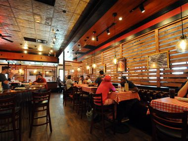 Gino's East Chicago Pizzeria in Arlington is pictured prior to the coronavirus pandemic. Like many restaurants throughout the state, it is set to open for dine-in eating on Friday.