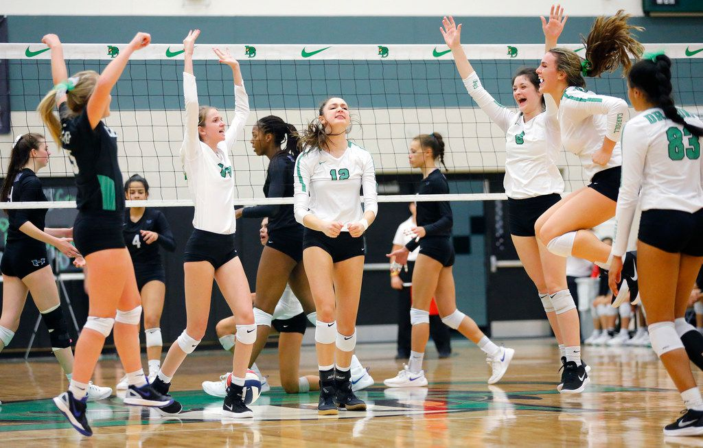 Southlake Carroll players celebrate a point during Tuesday's 27-25, 25-23, 25-22 victory against defending Class 6A state champion Hebron in a first-round playoff match at Lake Dallas. (Tom Fox/The Dallas Morning News)
