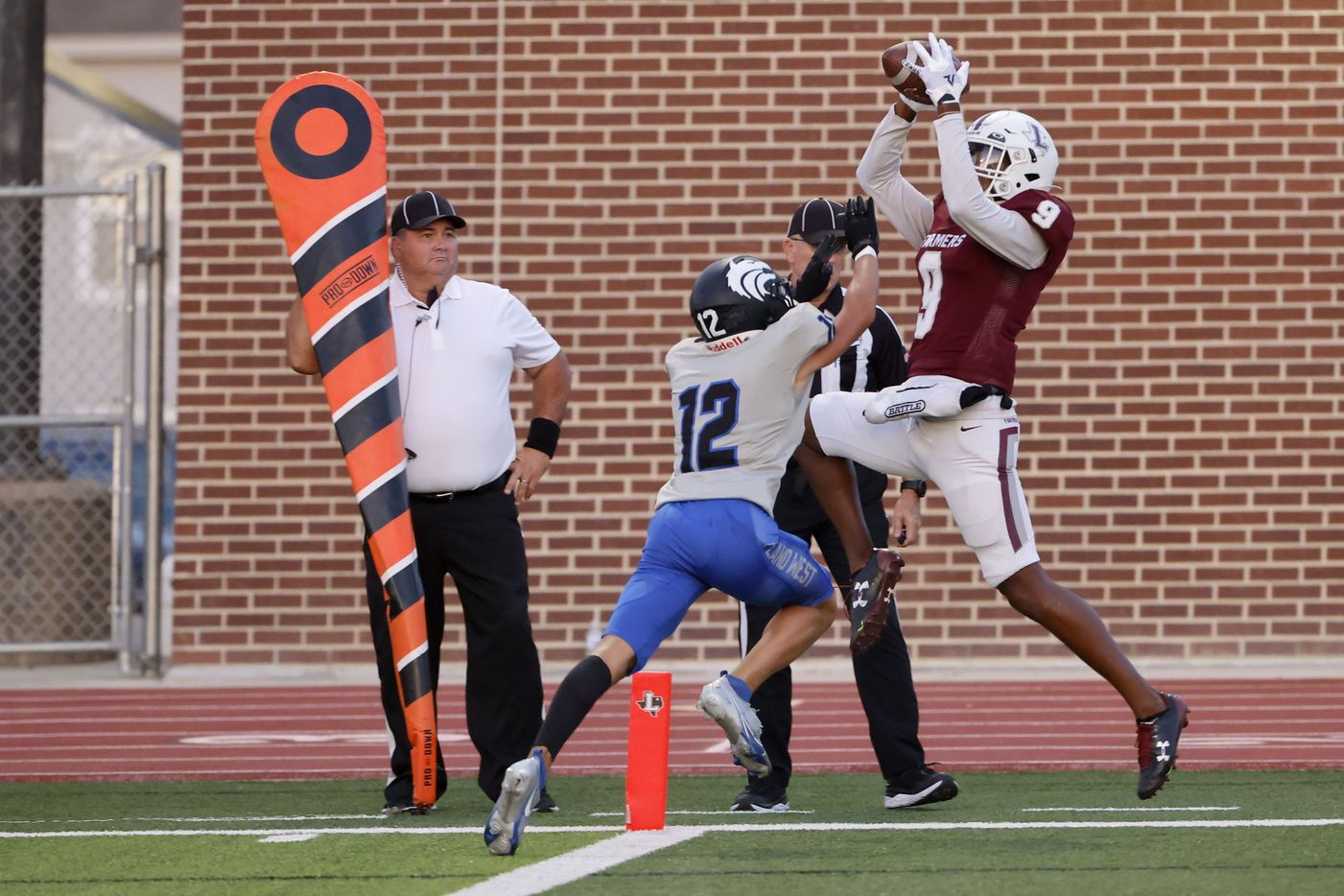 Lewisville receiver Armani Winfield (9) catches a touchdown in front of Plano West defender Donovan Martin (12) during the first half of a high school football game in Lewisville, Texas on Friday, Sept. 24, 2021. (Michael Ainsworth/Special Contributor)