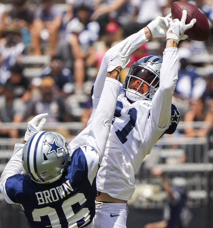 Dallas Cowboys cornerback Kyron Brown (36) breaks up a pass intended for wide receiver Simi Fehoko (81) during a practice at training camp on