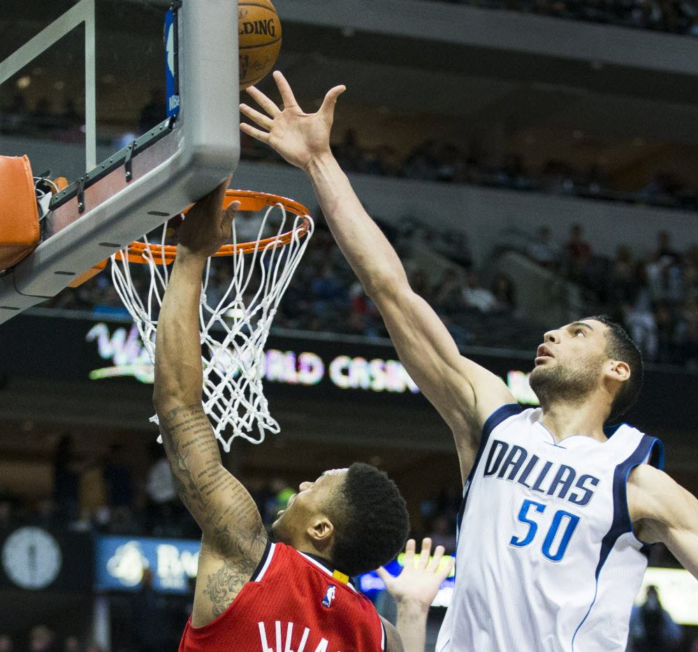 Dallas Mavericks center Salah Mejri (50) blocks a shot by Portland Trail Blazers guard Damian Lillard (0) during an NBA basketball game at American Airlines Center on Sunday, March 20, 2016, in Dallas. (Smiley N. Pool/The Dallas Morning News)