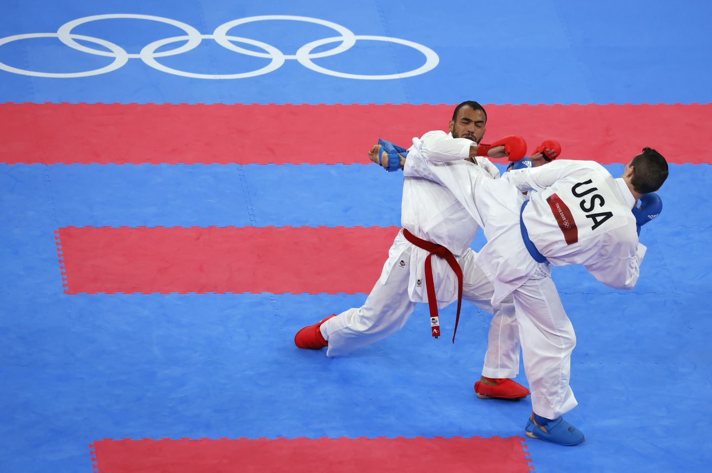 USA's Tom Scott competes against Egypt's Abdalla Abdelaziz during the karate men's kumite -75kg elimination round at the postponed 2020 Tokyo Olympics at Nippon Budokan, on Friday, August 6, 2021, in Tokyo, Japan. Scott defeated Abdelaziz 7-6. Scott finished in fourth place in his pool and did not advance to the next round. (Vernon Bryant/The Dallas Morning News)