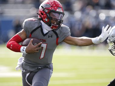 Cedar Hill High School quarterback Kaidon Salter (7) uses a stiff arm on a run during the first half as Denton Guyer High School played Cedar Hill High School in the Class 6A Division II, state semifinal at McKinney ISD Stadium in McKinney on Saturday, January 9, 2021.