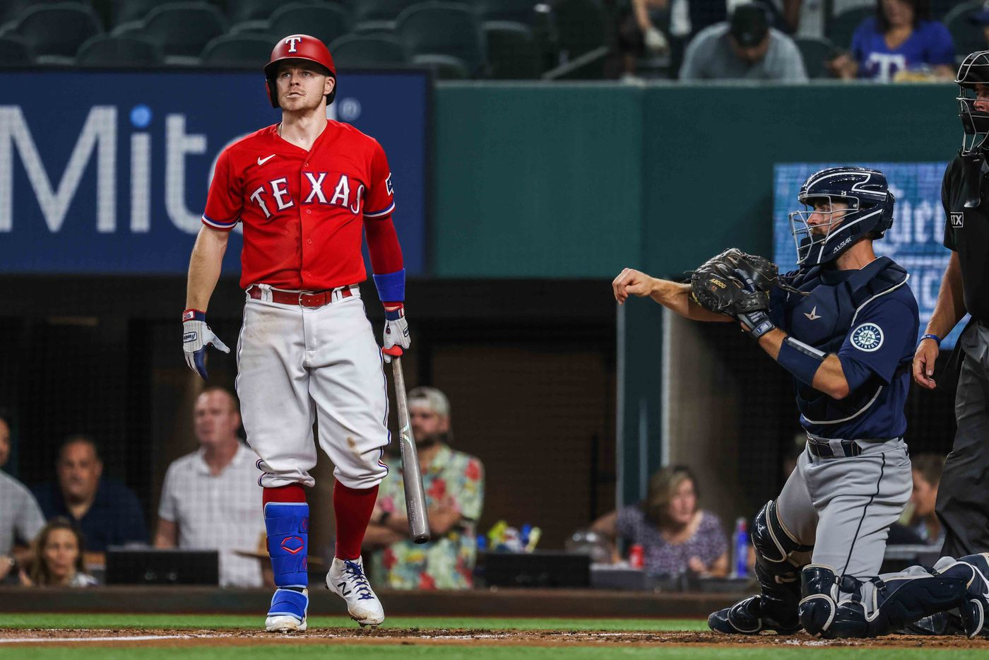 Texas Rangers Brock Holt (16) reacts after his second strike against Seattle Mariners during the first inning at Globe Life Field in Arlington, Texas, Friday, July 30, 2021. (Lola Gomez/The Dallas Morning News)