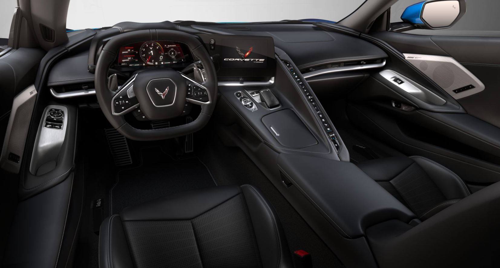 The interior of the 2020 Chevrolet Corvette C8 Stingray. Note the large screens and long wall of buttons on the center console.