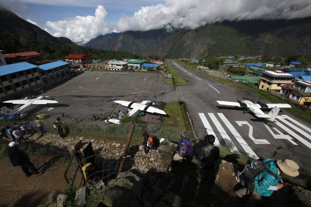 The airport in Lukla has long been considered one of the most dangerous in the world, with a runway of a mere 1,700 feet in length — vs. the typical 6,000 to 8,000 feet. The runway slopes upward to help arriving planes slow down and avoid hitting a solid rock wall.