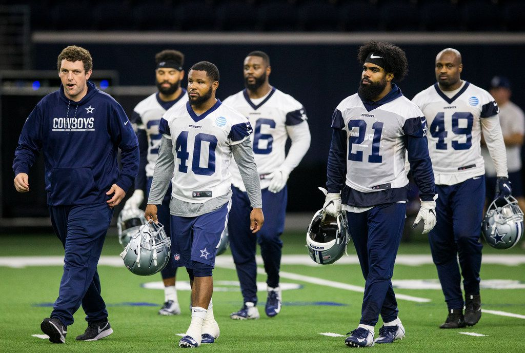 Dallas Cowboys running backs walk on the field during a Dallas Cowboys OTA practice on Wednesday, May 22, 2019 at The Star in Frisco. (Ashley Landis/The Dallas Morning News)
