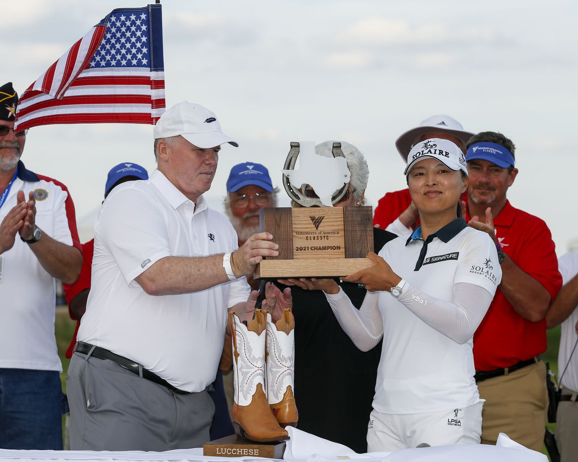 Professional golfer Jin Young Ko lifts the winner's trophy after winning the LPGA VOA Classic on Sunday, July 4, 2021, in The Colony, Texas. Ko finished the tournament 16 under par and one shot ahead of Matilda Castren. (Elias Valverde II/The Dallas Morning News)