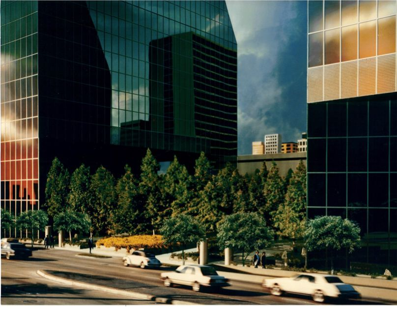A photo of the original model of the Fountain Place block showing two matching towers connected with a landscaped plaza.
