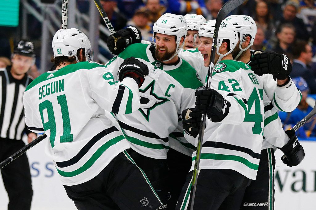 Dallas Stars' Jamie Benn (14) celebrates with teammates after scoring a goal against the St. Louis Blues during the first period of an NHL hockey game Saturday, March 2, 2019, in St. Louis. (AP Photo/Dilip Vishwanat)