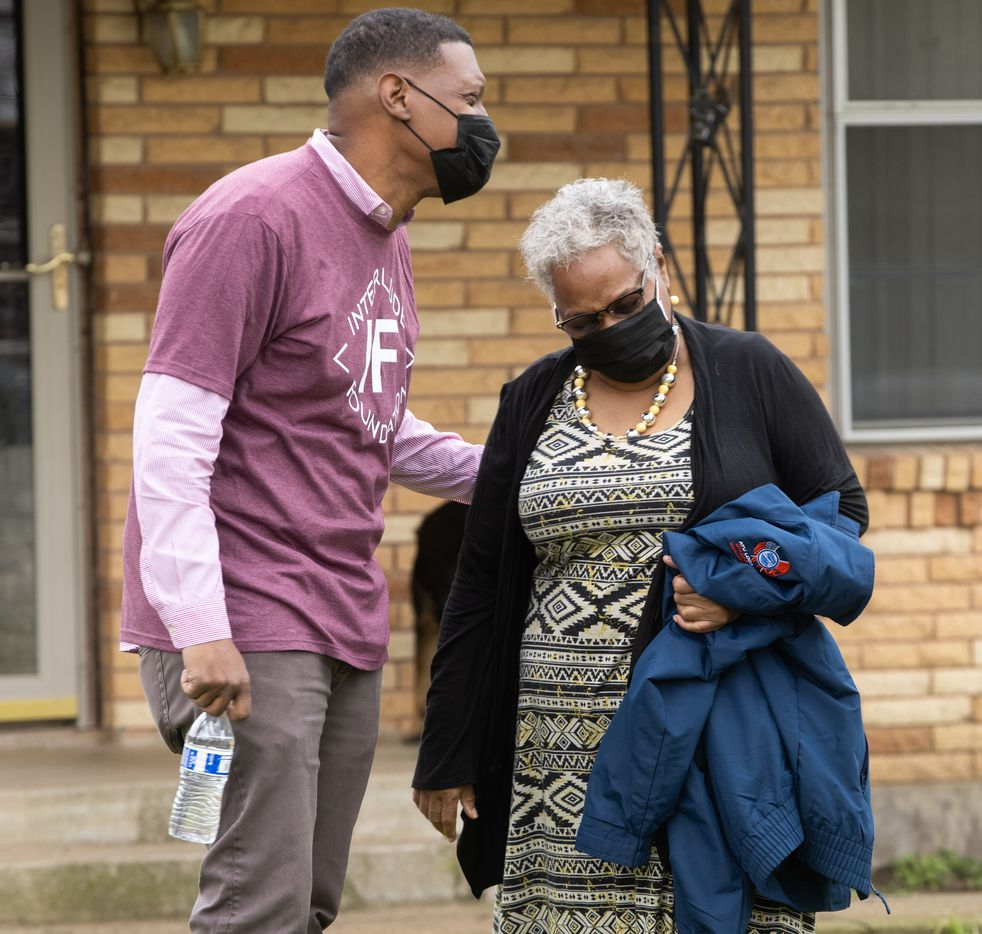 Quincy Roberts, the contractor who moved Shingle Mountain, surprises Marsha Jackson (right) with a concert outside of her home in Dallas on Friday, Feb. 26, 2021. (Juan Figueroa/ The Dallas Morning News)