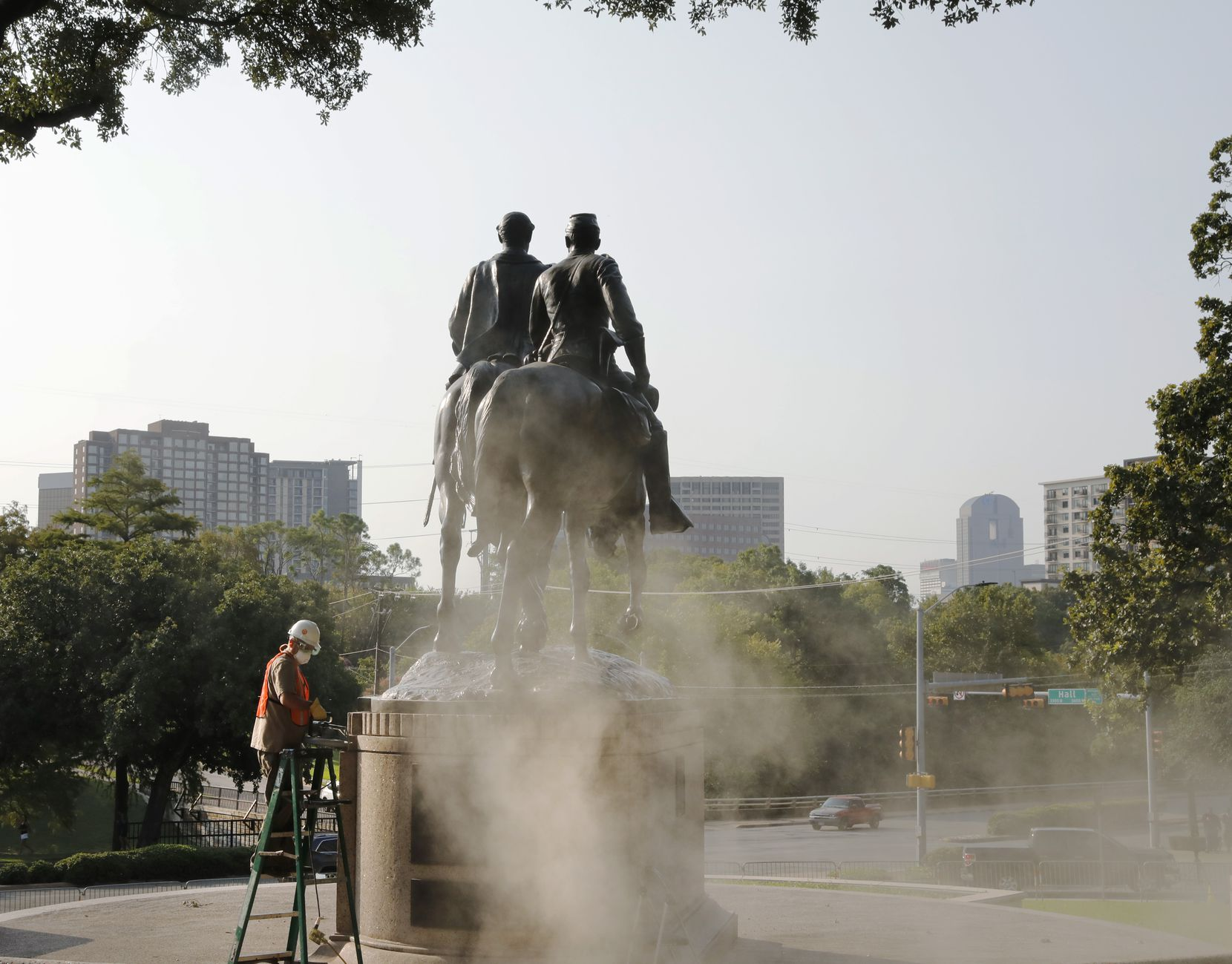 Michael van Enter works on removing the Robert E. Lee statue at Robert E. Lee Park in Dallas on  Sept. 8, 2017.