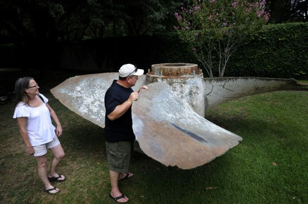Richard and Sherry King of Pea Ridge, Ark., check out the 106-year-old propeller in the sculpture garden of the Hilton Anatole in Dallas.