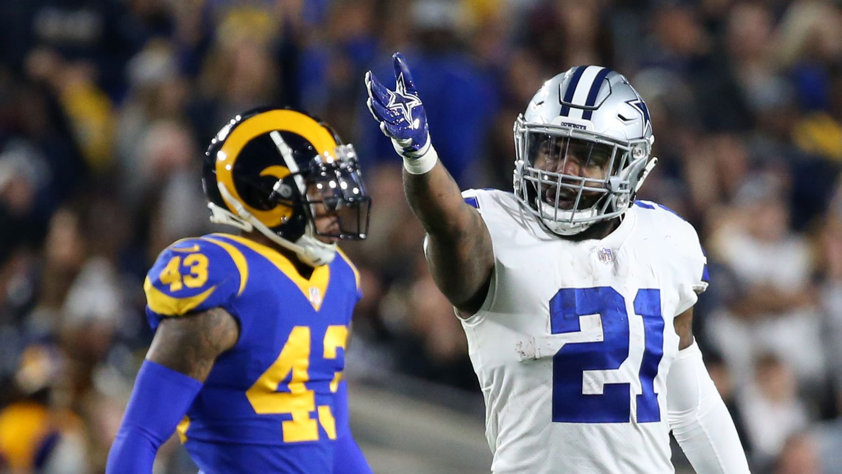 Dallas Cowboys running back Ezekiel Elliott (21) celebrates after moving the ball against the Los Angeles Rams in the first quarter of the NFC divisional round playoff game at Los Angeles Memorial Coliseum in Los Angeles, Calif. on Saturday, Jan. 12, 2019.