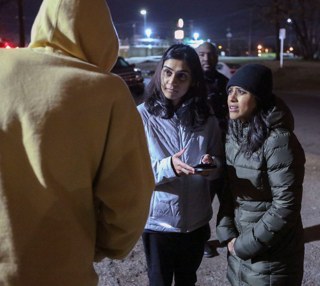 Metro Dallas Homeless Alliance volunteers Nazia Shaik (center) and Sana Syed interview a homeless woman in South Dallas on Jan. 25.