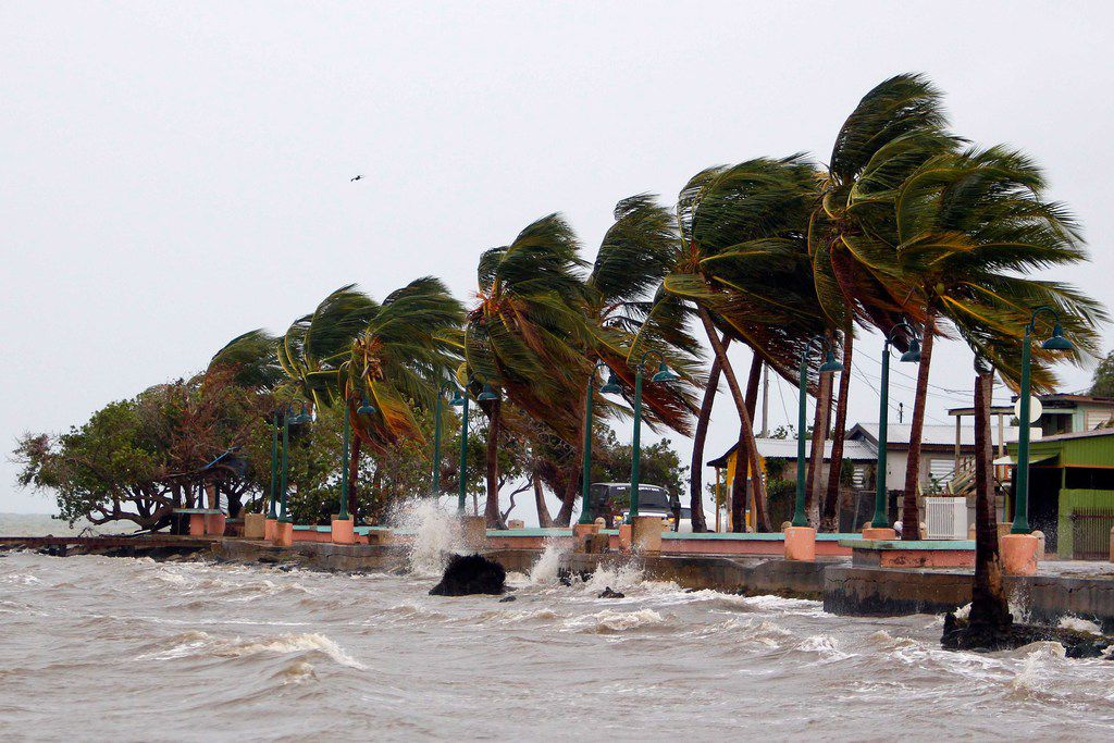 """Winds lash the coastal city of Fajardo as Hurricane Maria approaches Puerto Rico, on September 19, 2017.  Maria headed towards the Virgin Islands and Puerto Rico after battering the eastern Caribbean island of Dominica, with the US National Hurricane Center warning of a """"potentially catastrophic"""" impact. / AFP PHOTO / Ricardo ARDUENGORICARDO ARDUENGO/AFP/Getty Images"""