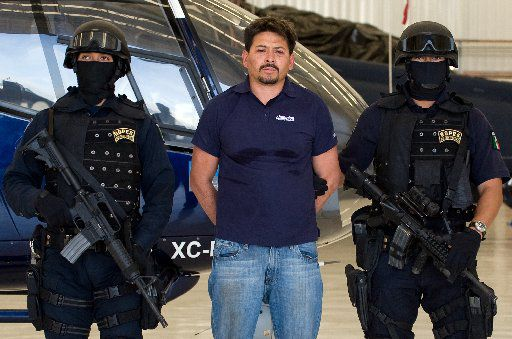 "Arnoldo Rueda-Medina, aka ""La Minsa,"" a member of the La Familia drug cartel, was presented to the media at Mexican Federal Police headquarters in Mexico City on July 11, 2009."
