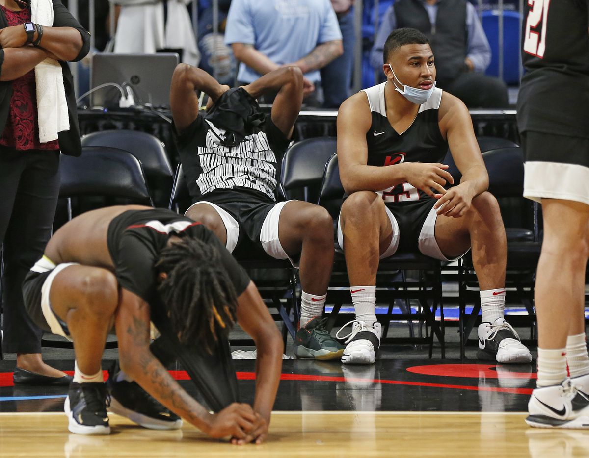 Kimbal players react after losing in OT to Beaumont. UIL boys Class 5A basketball state championship game on Friday, March 12, 2021 at the Alamodome.