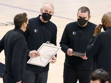 Dallas Mavericks head coach Rick Carlisle (second from left) gathers his assistants together during a second quarter timeout against the Detroit Pistons at the American Airlines Center in Dallas, Wednesday, April 21, 2021.(Tom Fox/The Dallas Morning News)