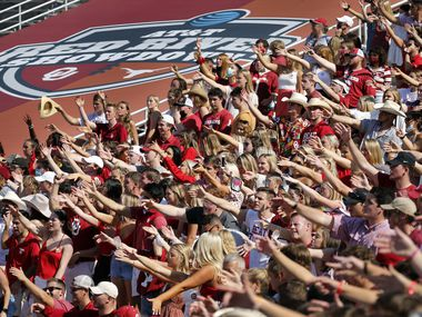 The student section compressed into a sea of people as their team played in overtime against the Texas Longhorns. Oklahoma won the Red River Rivalry in quadruple overtime, 53-45, at the Cotton Bowl in Dallas, Saturday, October 10, 2020. (Tom Fox/The Dallas Morning News)