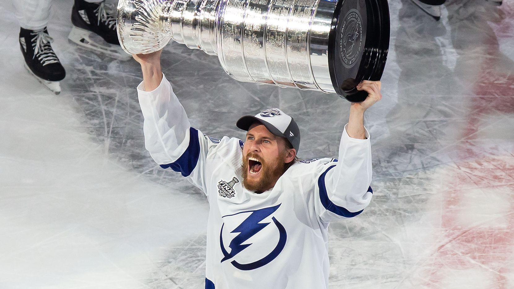 Blake Coleman (20) of the Tampa Bay Lightning hoists the Stanley Cup after defeating the Dallas Stars during Game Six of the Stanley Cup Final at Rogers Place in Edmonton, Alberta, Canada on Monday, September 28, 2020. (Codie McLachlan/Special Contributor)