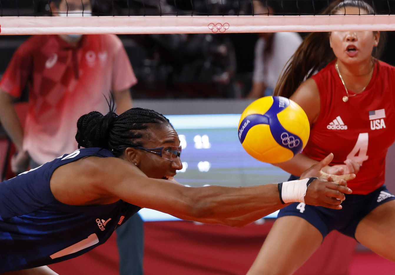 USA's Foluke Akinradewo (16) dives for the ball in a volleyball game against Argentina during the postponed 2020 Tokyo Olympics at Ariake Arena on Sunday, July 25, 2021, in Tokyo, Japan. USA defeated Argentina 3-0 (25-20, 25-19, 25-20). (Vernon Bryant/The Dallas Morning News)