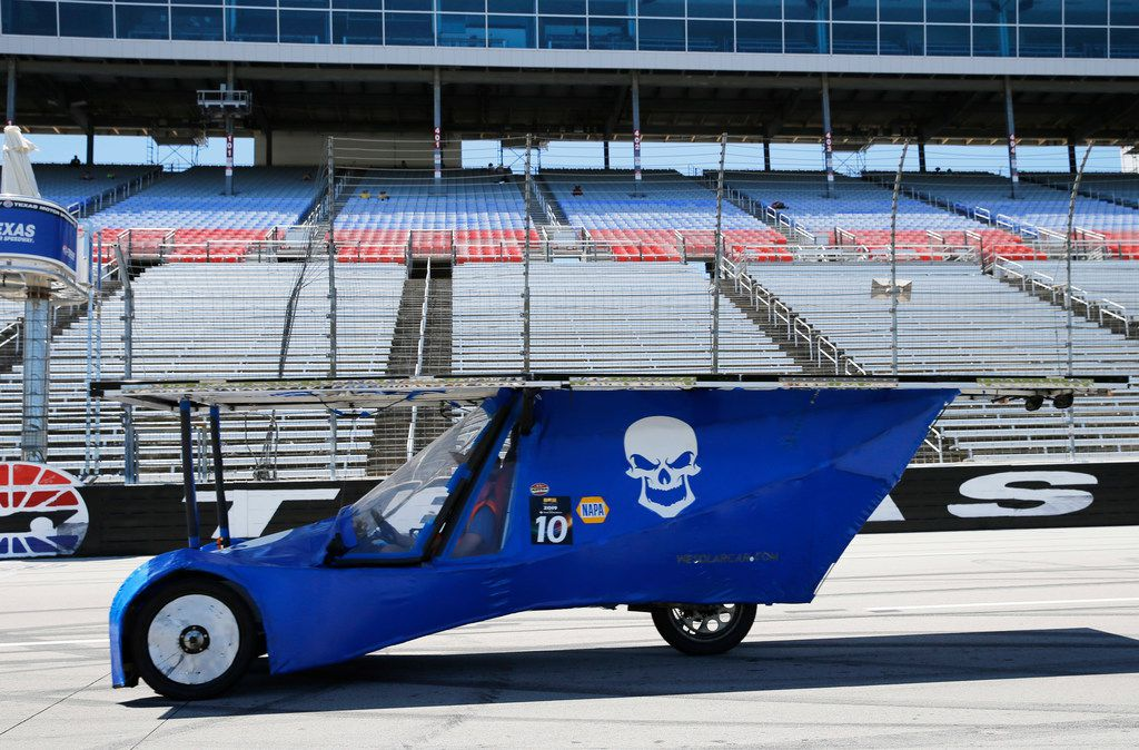 Jaxson Hill, 18, of Wylie East High School rides East Beast for the school's Solar Car Challenge team at Texas Motor Speedway in Fort Worth on Thursday, July 18, 2019.
