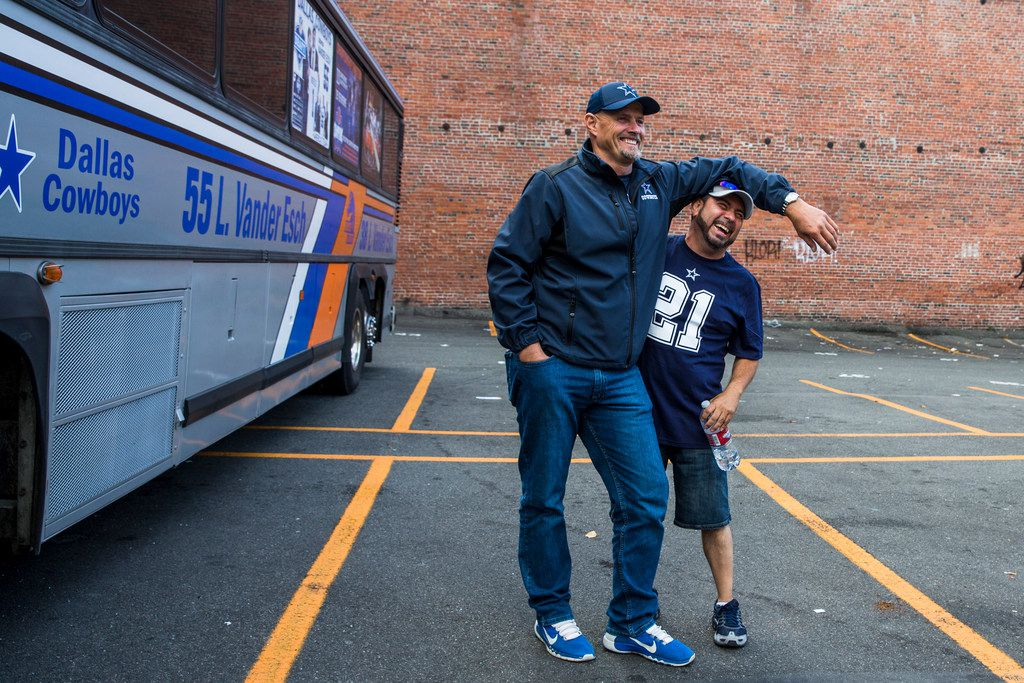"Darwin Vander Esch takes a picture in front of his bus, the ""Vander Esch express,""  with Ralph Garza, of Sunnyside, Washington, before a NFL game between the Dallas Cowboys and Seattle Seahawks on Sunday, September 23, 2018 at CenturyLink Field in Seattle. (Shaban Athuman/The Dallas Morning News)"