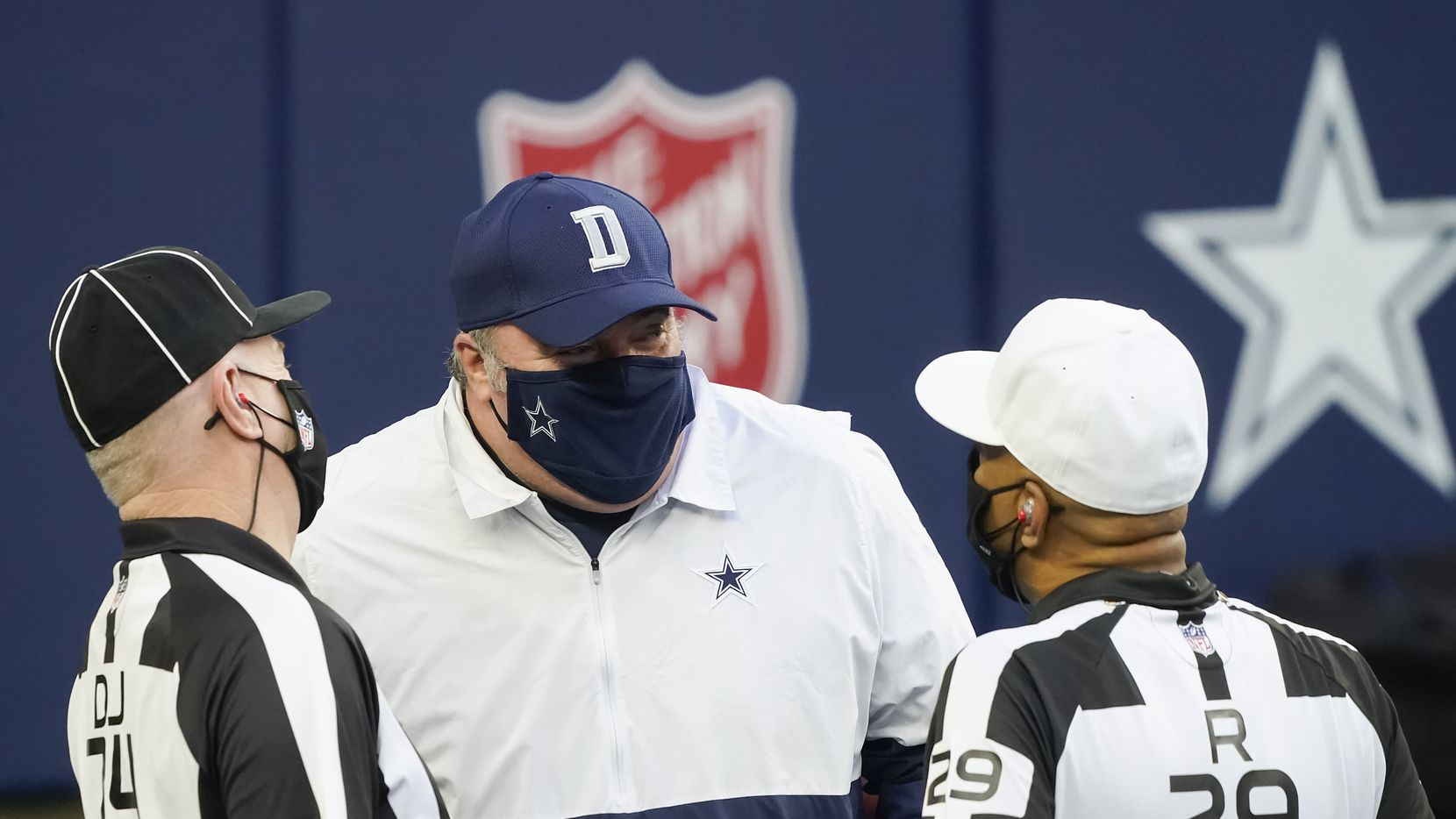 Dallas Cowboys head coach Mike McCarthy talks with officials before an NFL football game against the Philadelphia Eagles at AT&T Stadium on Sunday, Dec. 27, 2020, in Arlington.