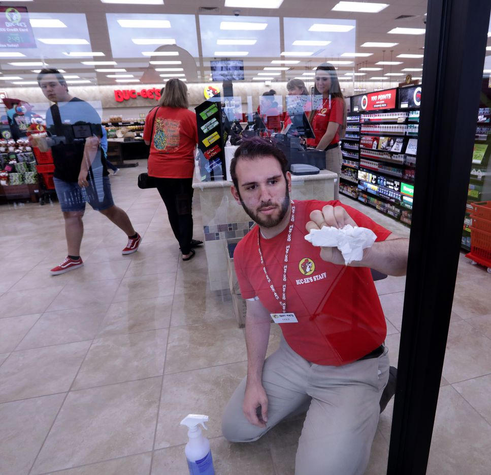 Cole Palmer cleans the windows at the new Buc-ee's in Melissa, TX, on Apr. 29, 2019.