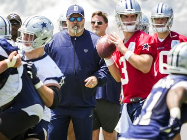 Dallas Cowboys head coach Mike McCarthy watches as quarterback Garrett Gilbert (3) runs a play during the first practice of the team's training camp on Thursday, July 22, 2021, in Oxnard, Calif.