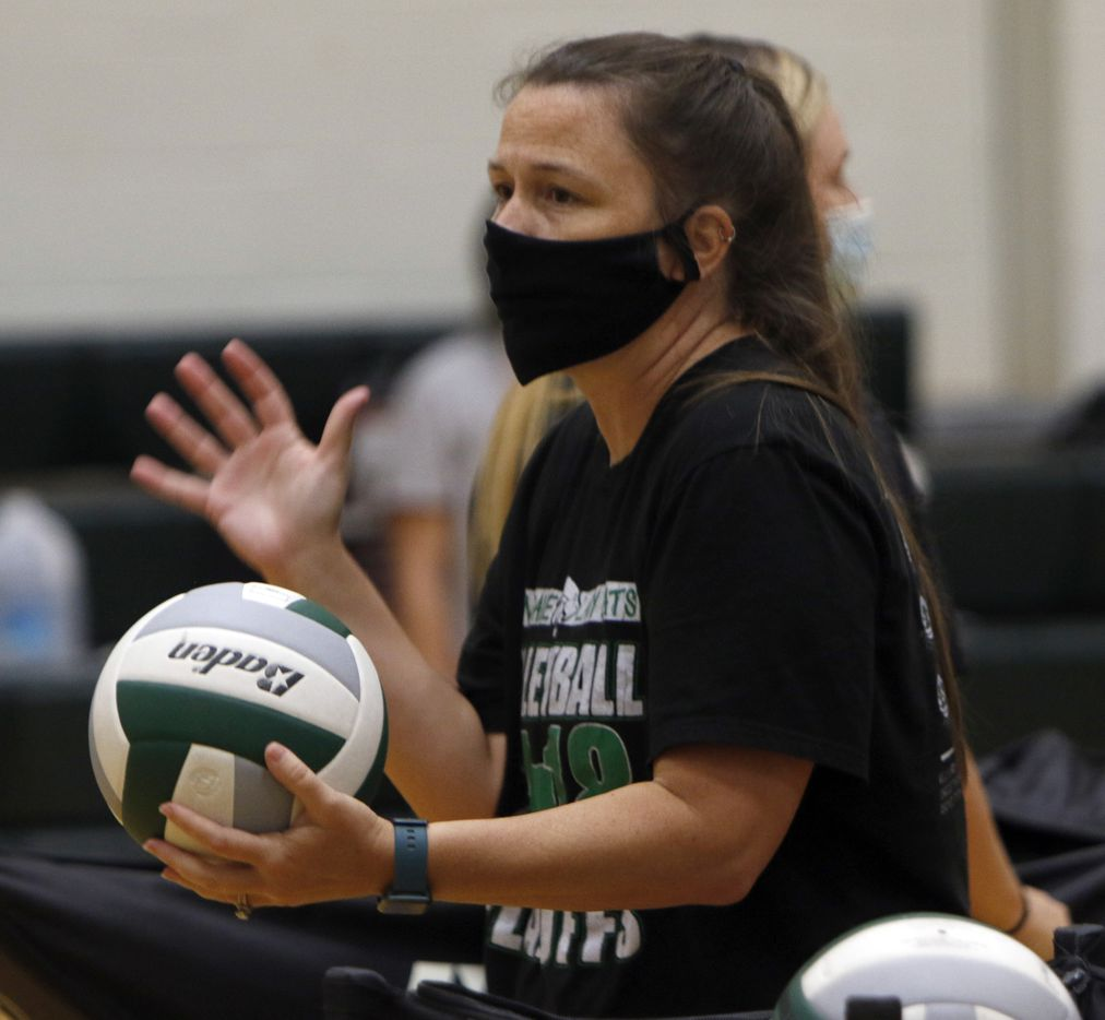 Kelly Carl, varsity volleyball head coach of the Lady Kats of Kennedale leads her players through a set of drills. Under the direction of Carl, the team conducted their first practice of the season at Kennedale High School in Kennedale on August 03, 2020.(Steve Hamm/ Special Contributor)
