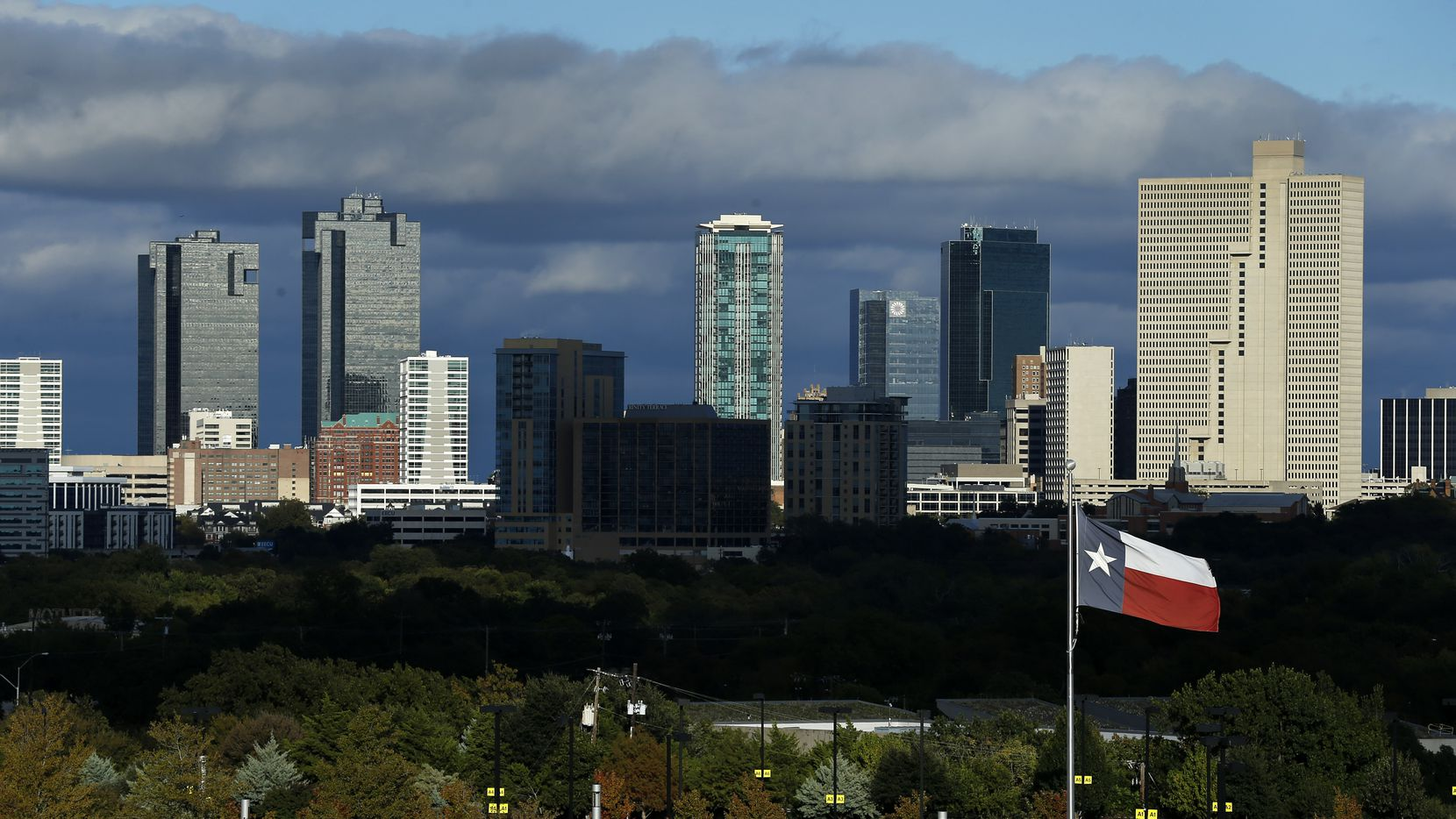 After several days of mist and rain, clouds began to dissipate over the Fort Worth skyline, Wednesday afternoon, October 28, 2020. Temperatures should begin rising going into the weekend after lows in the 30's. (Tom Fox/The Dallas Morning News)