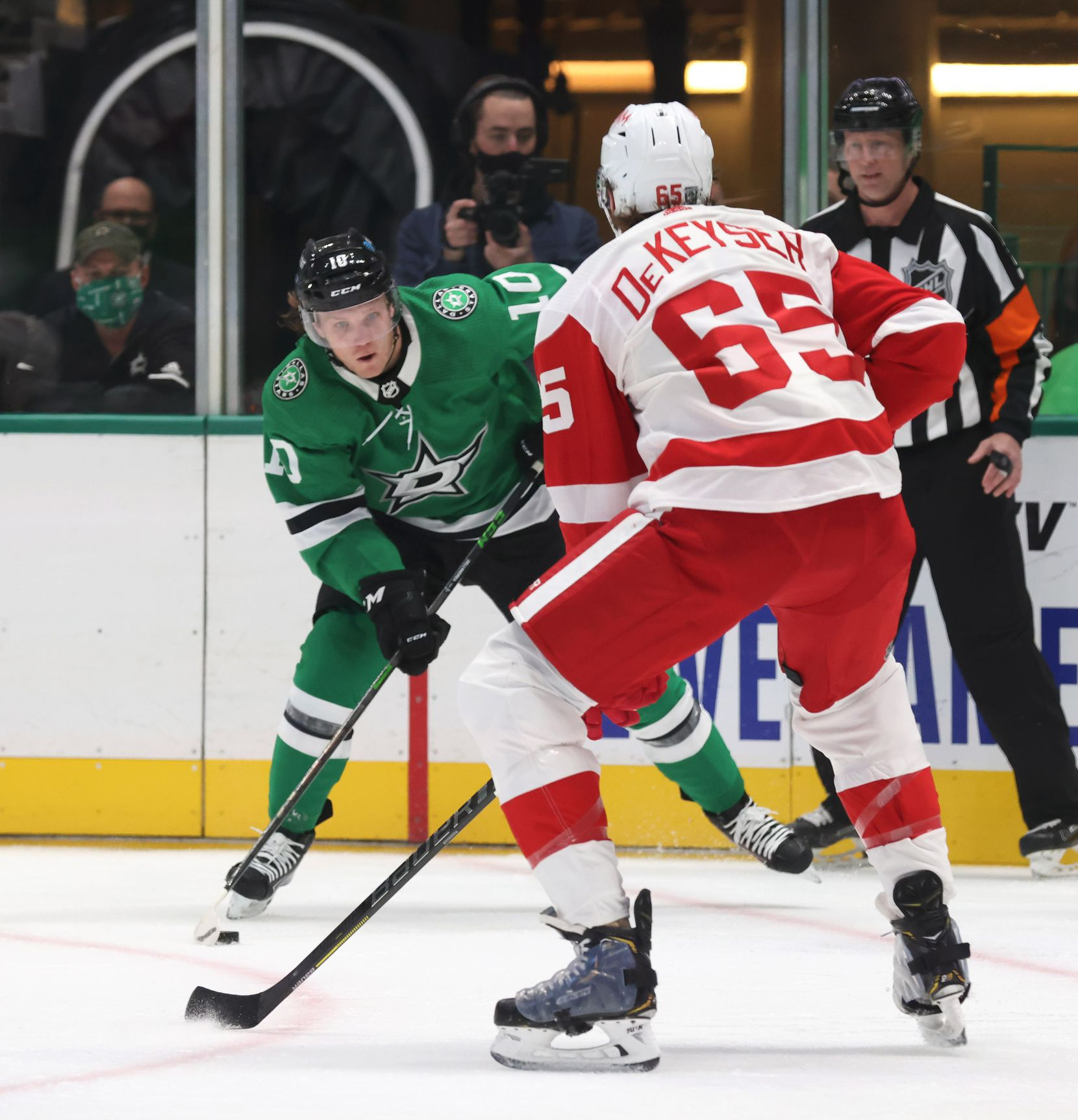 Dallas Stars Ty Dellandrea (10) advances the puck as Detroit Red Wings defenseman Danny DeKeyser (65) defends during the first period of play at American Airlines Center on Tuesday, January 26, 2021in Dallas. (Vernon Bryant/The Dallas Morning News)