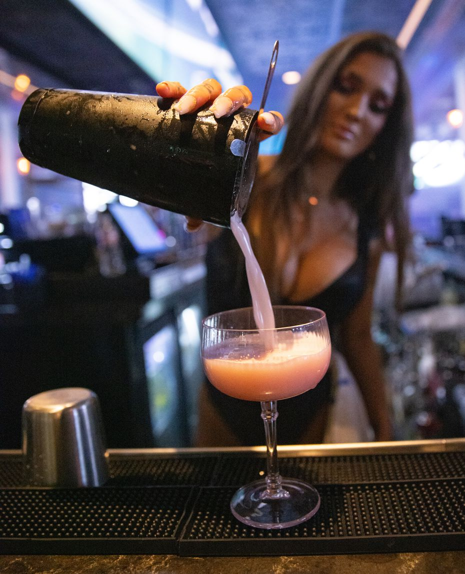Olivia Empié prepares the Blüm cocktail at Blüm, which is the nightclub attached to The Sporting Club in Dallas.