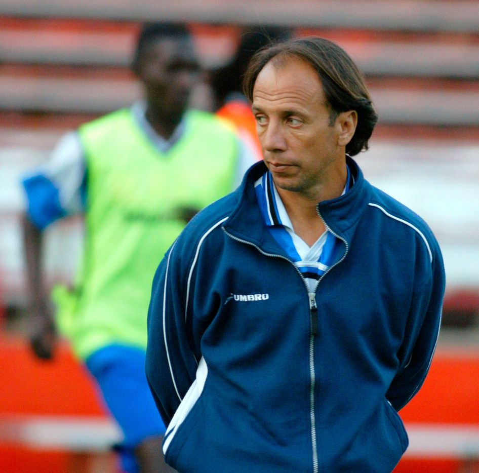 FILE - In this March 12, 2004, file photo, Haiti men's national team soccer coach Fernando Clavijo watches his team warm up at the Orange Bowl in Miami. Clavijo, a surprise starter for the 1994 U.S. World Cup team who went on to a coaching and management career in Major League Soccer, died Friday, Feb. 8, 2019, at his home in Fort Lauderdale, Fla., from multiple myeloma. He was 63. (AP Photo/Luis M. Alvarez, File)