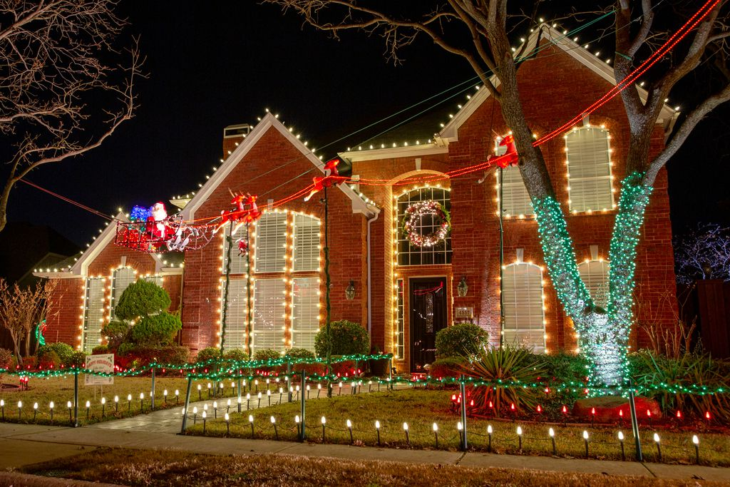 Holiday lights and decorations adorn houses on Dec. 3, 2019 in the Deerfield neighborhood in Plano, Texas. (Kara Dry/Special Contributor)