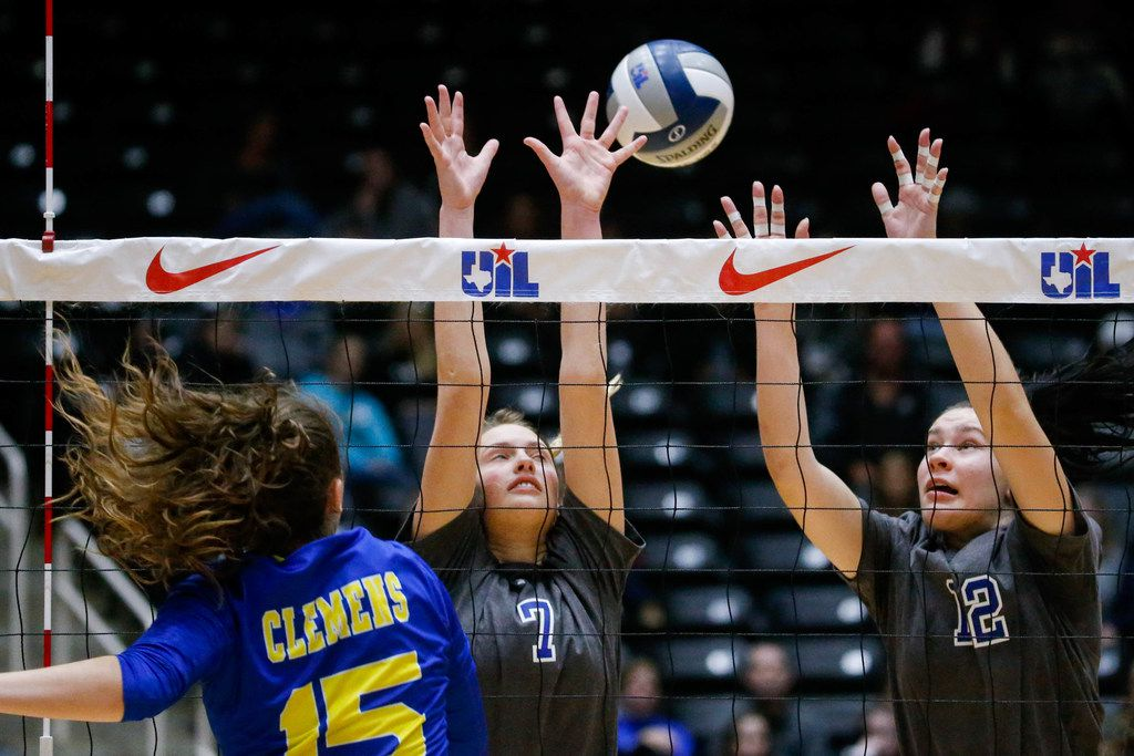Byron Nelson's Nina Petersen (7) and Payton Chamberlain (12) attempt to block Schertz Clemens' Shelby O'Neal (15) hit during the first set of a class 6A volleyball state semifinal match at the Curtis Culwell Center in Garland, on Friday, November 22, 2019. Nelson won the first set 32-30. (Juan Figueroa/The Dallas Morning News)