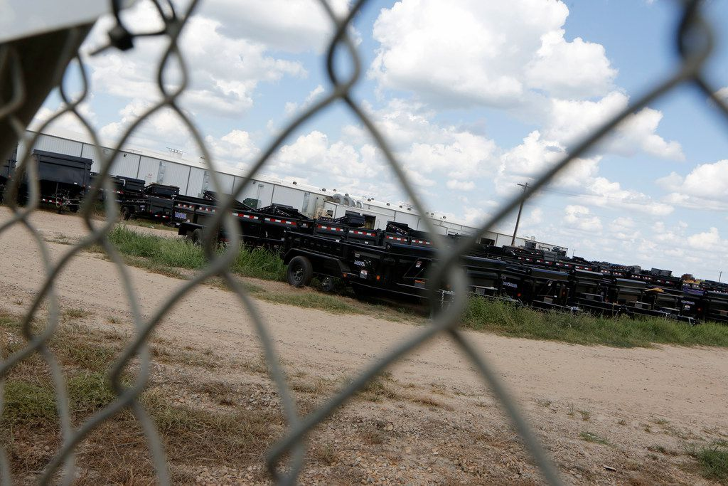 Trailers sit in the field after Immigration and Customs Enforcement raided Load Trail LLC. trailer manufacturer in Sumner, Texas on Aug. 28, 2018.