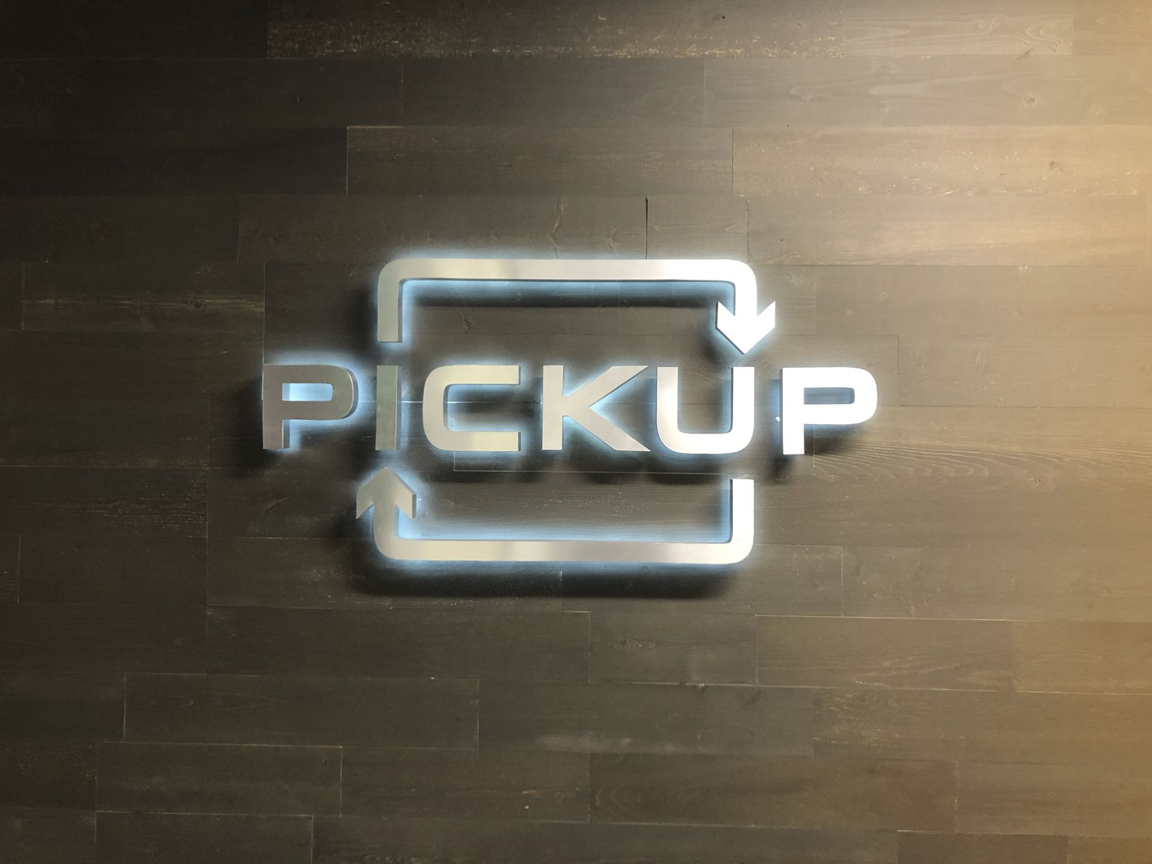 Plano-based Pickup's logo is shown at its headquarters at 5068 Plano Parkway.