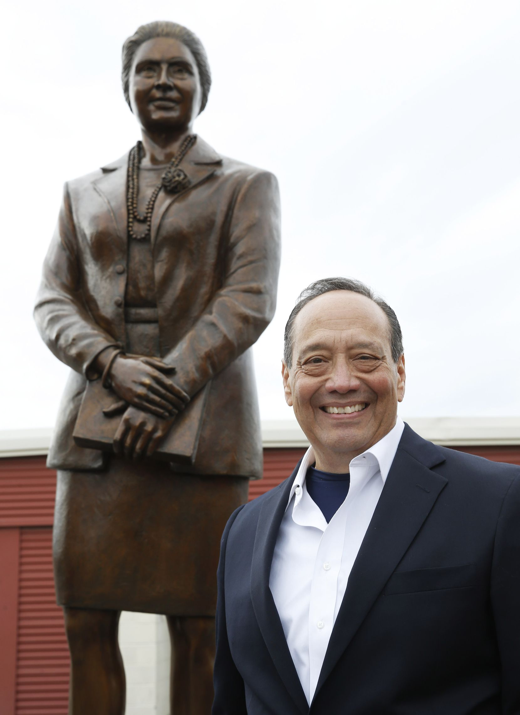 JD Gonzales poses for a portrait next to a statue of Adelfa B. Callejo statue by artist German Michel at a storage facility in Dallas on Wednesday. Adelfa Callejo was a fierce civil rights defender and lawyer who died nearly 6 years ago. Gonzales is Adelfa's nephew.